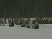 Stock Video Footage of Reindeer pull sleighs across a snowy landscape