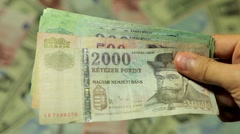 Payment, Loan or Borrow Money Cash, Salary, Tax, Income, Hungarian Forint HUF Stock Footage