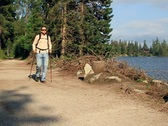 Stock Video Footage of Man nordic walking by the lake, slow motion NTSC