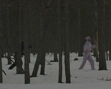 A man and a woman cross country skiing Stock Footage
