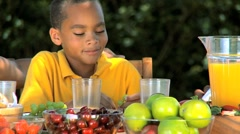 Little Ethnic Boy Enjoying Grapes with Lunch Stock Footage