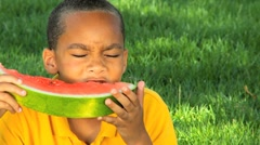 Young Ethnic Boy Eating Refreshing Water Melon Stock Footage
