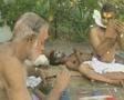 Goa / Cochin Kathakali Dancers applying makeup Footage