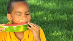 African American Child Enjoying Water Melon Stock Footage