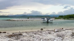 Puerto Rico-Boat on deserted coral island at lagoon entrance Stock Footage