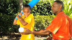 Ethnic Father & Son Practicing Baseball Stock Footage