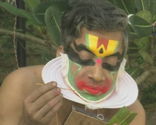 Goa / Cochin Kathakali Dancer applying makeup Stock Footage