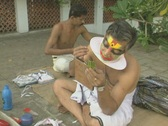 Stock Video Footage of Goa / Cochin Kathakali Dancers applying makeup
