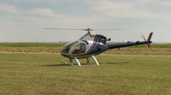 Aircraft, rotorway exec turbine helicopter idle on ground Stock Footage