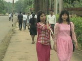 Goa / Cochin People walking along the street in India Stock Footage