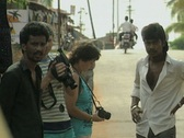 Stock Video Footage of Goa / Cochin Man with camcorder filming on the street