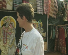 Goa / Cochin Woman examines fabric prints for sale Stock Footage