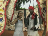 Stock Video Footage of Goa / Cochin Man and woman discuss carpets