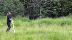 Scything the grass Stock Footage