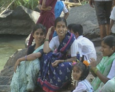 Goa / Cochin Group of Indian people sitting near the water Stock Footage