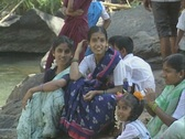 Stock Video Footage of Goa / Cochin Group of Indian people sitting near the water