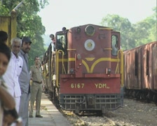 Goa / Cochin Indian railways train arrives at the station Stock Footage