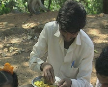 Goa / Cochin Young Indian man eats food with his fingers Stock Footage