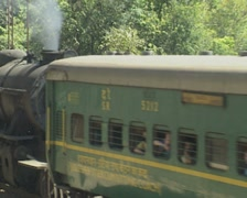 Goa / Cochin Steam Train pushes carriages - Indian Railways Stock Footage