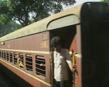 Goa / Cochin Steam engine pushes passenger carriages on Indian Railways - stock footage