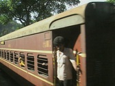 Stock Video Footage of Goa / Cochin Steam engine pushes passenger carriages on Indian Railways