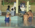 Goa / Cochin Hotel guests at the swim up bar SD Footage