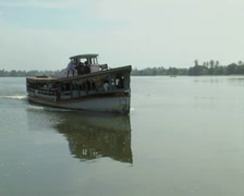 Goa / Cochin Sightseeing boat travels along the canal - stock footage