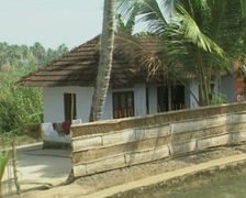 Goa / Cochin Small cottages on the banks of the canal Stock Footage