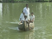 Stock Video Footage of Goa / Cochin Men being rowed down a canal, one of them standing in the boat