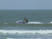 Stock Video Footage of Goa / Cochin Man rides a jet ski through the waves