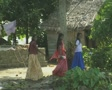 Goa / Cochin Three Indian women walking along the canal, traditional and modern SD Footage