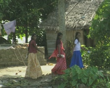 Goa / Cochin Three Indian women walking along the canal, traditional and modern Stock Footage
