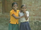 Stock Video Footage of Goa / Cochin Two shy young Indian girls smiling and laughing at the camera