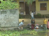 Stock Video Footage of Goa / Cochin Indian women washing clothes in the canal
