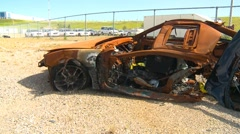 Crime and justice, destroyed and burnt Acura due to impaired driver, montage Stock Footage