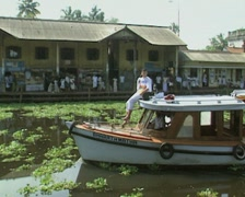 Goa / Cochin Sightseeing boat travels along a canal - stock footage