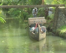 Goa / Cochin Indian man and woman in a boat on the canal Stock Footage