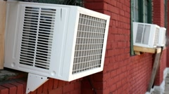 Air conditioners on side of building dripping Stock Footage