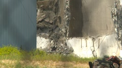 Concrete seed mill demolition with jaws debris falling, #9 Stock Footage