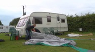 Stock Video Footage of Erecting a caravan awning - time lapse
