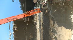 Concrete seed mill demolition with jaws debris falling, #8 Stock Footage