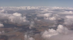 Aerial View of Clouds from Airplane - stock footage