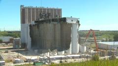 Concrete seed mill demolition very wide, ca.1915 grain elevator, #5 Stock Footage