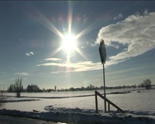 Sun over snowy polders Stock Footage