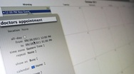 Calendar application on screen of Laptop Stock Footage