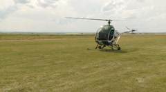Helicopter, Shwiezer 269C1 helicopter takeoff Stock Footage