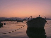 Stock Video Footage of View of moored boats and sunset