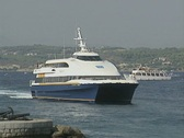 Catamaran slowly arrives at Spetses harbour Stock Footage