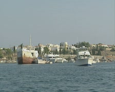 The Spetses shoreline seen from a boat out at sea Stock Footage