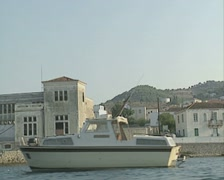 The coastline of Spetses as seen from the sea with an expensive looking building Stock Footage